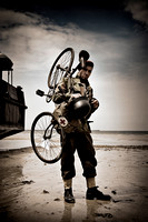 Bicyclist on Gold Beach. Arromanches, Normandy, France.