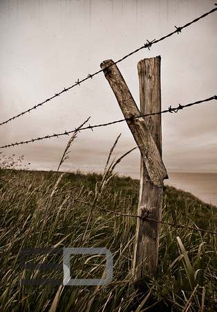 Fence on the cliff of Pointe Du Hoc. Normandy, France.
